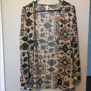Fun print cardigan! Light weight and semi see thru